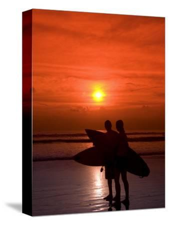 Two Surfers Calling it a Day, Kuta Beach, Bali, Indonesia, Southeast Asia, Asia-Richard Maschmeyer-Stretched Canvas Print