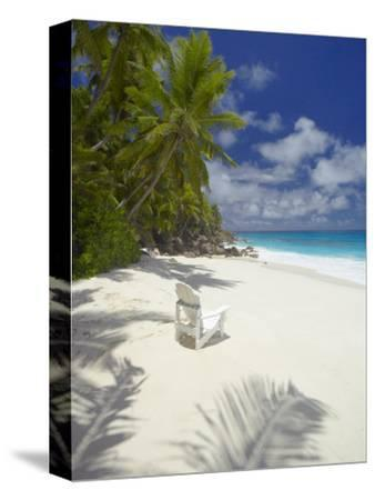 Adirondack Chair and Tropical Beach, Seychelles, Indian Ocean, Africa-Sakis Papadopoulos-Stretched Canvas Print