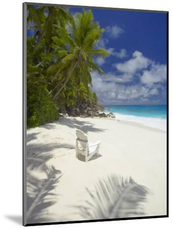 Adirondack Chair and Tropical Beach, Seychelles, Indian Ocean, Africa-Sakis Papadopoulos-Mounted Photographic Print