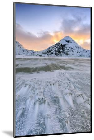 Wave Advances Towards the Shore of the Beach Surrounded by Snowy Peaks at Dawn-Roberto Moiola-Mounted Photographic Print