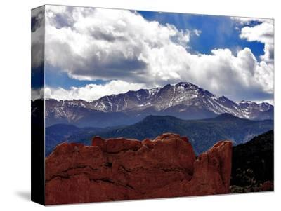 The Sun Breaks Through the Clouds to Highlight the Summit of Pikes Peak--Stretched Canvas Print