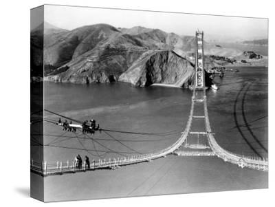 Workers Complete the Catwalks for the Golden Gate Bridge--Stretched Canvas Print