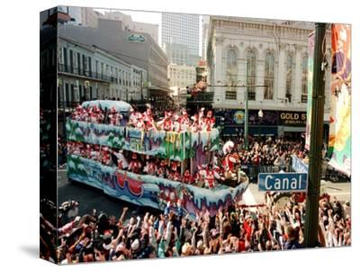 Mardi Gras Revellers Greet a Float from the Zulu Parade--Stretched Canvas Print