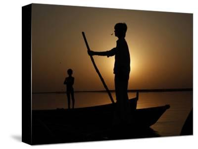 Boatman Prepares to Anchor His Boat, after the Day's Work in River Ganges, in Allahabad, India--Stretched Canvas Print