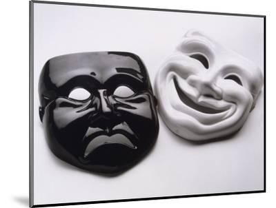 Black and White Image of Ceramic Theater Masks-Howard Sokol-Mounted Photographic Print