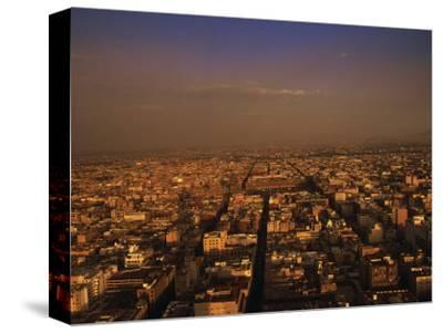 Aerial View of Mexico City, Mexico-Walter Bibikow-Stretched Canvas Print