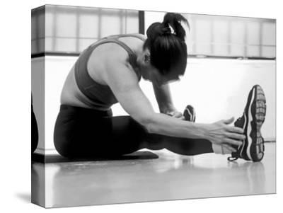 Women Stretching During Exercise Session, New York, New York, USA-Paul Sutton-Stretched Canvas Print