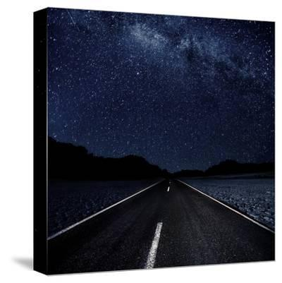 Highway And Starry Night In Desert--Stretched Canvas Print