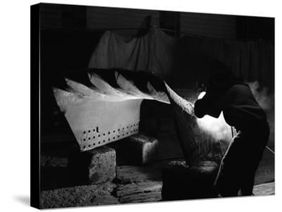Welding a Dragline Bucket, Edgar Allen Steel Co, Sheffield, South Yorkshire, 1962-Michael Walters-Stretched Canvas Print