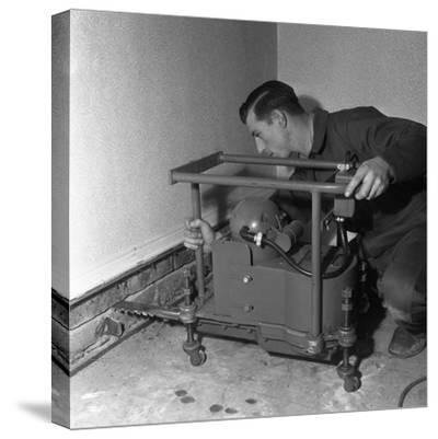 Installing a Damp Proof Course in a House in Goldthorpe, South Yorkshire, 1957-Michael Walters-Stretched Canvas Print