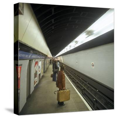 Passengers Waiting at Blackhorse Tube Station on the Victoria Line, London, 1974-Michael Walters-Stretched Canvas Print