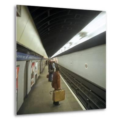 Passengers Waiting at Blackhorse Tube Station on the Victoria Line, London, 1974-Michael Walters-Metal Print