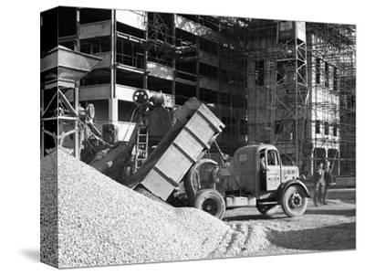 Early 1950S Bedford M Tipper Delivering Aggregates to a Building Site, South Yorkshire, July 1954-Michael Walters-Stretched Canvas Print