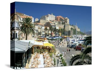 Restaurants in the Old Port with the Citadel in the Background, Calvi, Corsica-Peter Thompson-Stretched Canvas Print