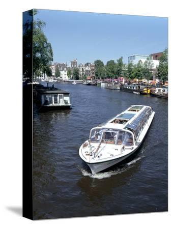 Amstel Canal and Bloumerbrug, Binnen, Amsterdam, Netherlands-Peter Thompson-Stretched Canvas Print