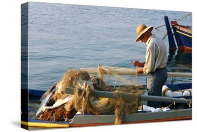 Man on Board a Fishing Boat, Sami, Kefalonia, Greece-Peter Thompson-Stretched Canvas Print