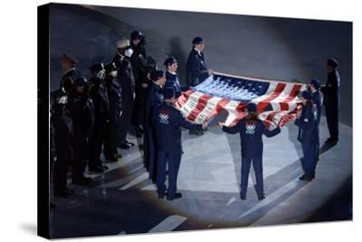 The Us Olympic Team Holds the American Flag That Flew over the Ground Zero--Stretched Canvas Print