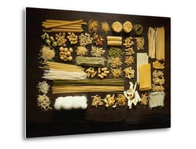 Many Different Types of Pasta on Dark Wooden Background-Walter Cimbal-Metal Print