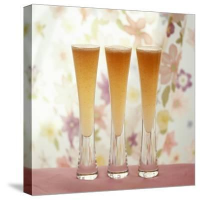 Three Glasses of Bellini (Sparkling Wine with Peach Juice)-Michael Paul-Stretched Canvas Print