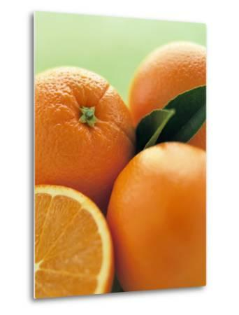 Oranges with Leaves Close Up-Leigh Beisch-Metal Print