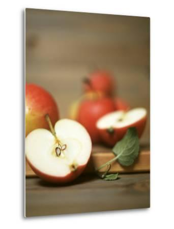 Several Apples, One Halved-Uwe Bender-Metal Print