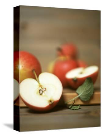 Several Apples, One Halved-Uwe Bender-Stretched Canvas Print