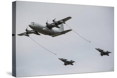 A Swedish Air Force C-130E Hercules with Two Czech Air Force Gripens in Tow-Stocktrek Images-Stretched Canvas Print