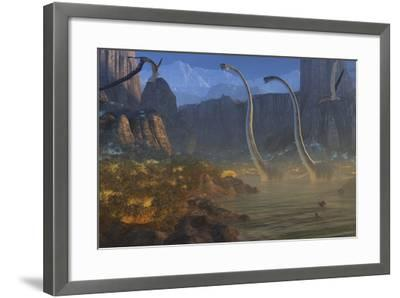 Two Omeisaurus Dinosaurs Crossing an Inlet with Flying Pterosaurs Flying Above-Stocktrek Images-Framed Art Print