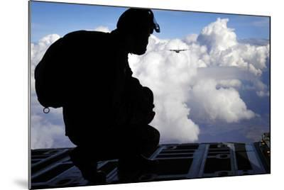 A Romanian Paratrooper Awaits His Signal to Jump Out of a C-130J Super Hercules-Stocktrek Images-Mounted Photographic Print