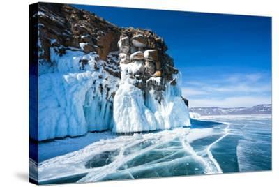 Baikal Lake. Ice and Icicles on a Rocky Island in Sunny Day-katvic-Stretched Canvas Print
