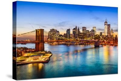 New York City, USA Skyline over East River and Brooklyn Bridge.-SeanPavonePhoto-Stretched Canvas Print