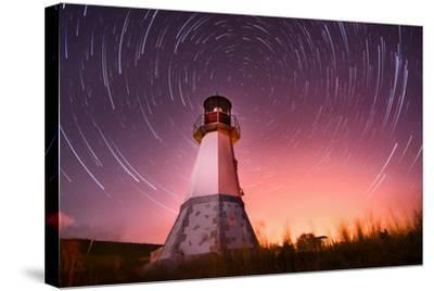 Lighthouse with Night Sky at Background Stars Trails- Q-lieb-in-Stretched Canvas Print