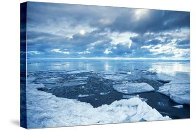 Winter Coastal Landscape with Floating Melting Ice Fragments-Eugene Sergeev-Stretched Canvas Print