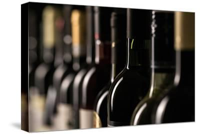 Row of Vintage Wine Bottles in a Wine Cellar (Shallow Dof; Color Toned Image)-l i g h t p o e t-Stretched Canvas Print