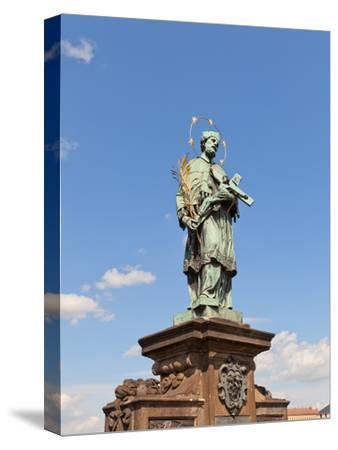 Statue of St. John of Nepomuk on Charles Bridge in Prague- joymsk-Stretched Canvas Print