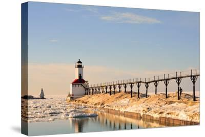 Lighthouse on Sunny Winter Day with Man Running- ErynnZ-Stretched Canvas Print