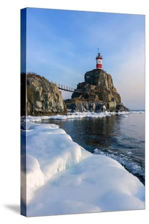 Winter Picture Lighthouse on a Lonely Rock.- vladsv-Stretched Canvas Print