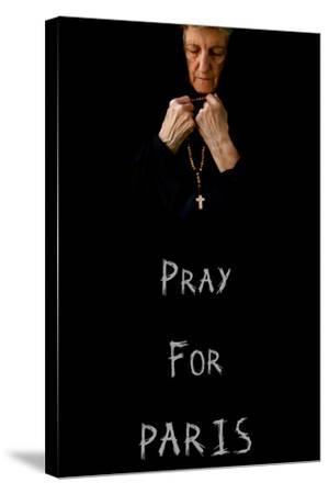 Pray for Paris.An Old Praying Woman in Black-Tolikoff Photography-Stretched Canvas Print
