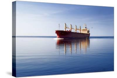 Cargo Ship Sailing in Still Water-aleksey.stemmer-Stretched Canvas Print