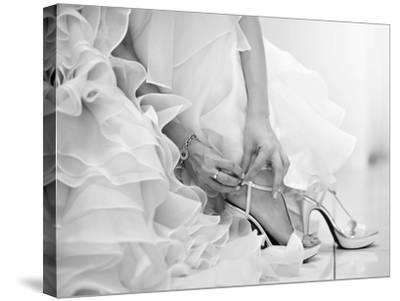The Bride is Putting on Her Shoes for the Wedding Day-szefei-Stretched Canvas Print