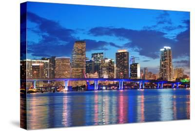 Miami City Skyline Panorama at Dusk with Urban Skyscrapers and Bridge over Sea with Reflection-Songquan Deng-Stretched Canvas Print