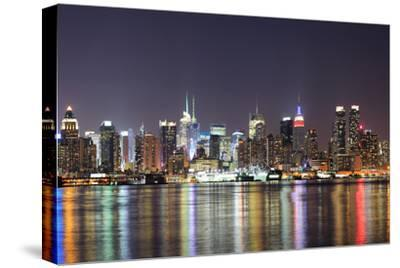 New York City Manhattan Midtown Skyline at Night with Lights Reflection over Hudson River Viewed Fr-Songquan Deng-Stretched Canvas Print