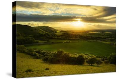 Stunning Countryside Landscape with Sun Lighting Side of Hills at Sunset-Veneratio-Stretched Canvas Print