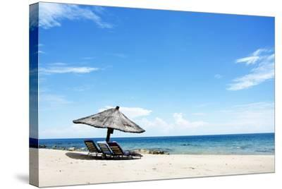 Umbrella on the Beach on a Sunny Day, Chintheche Beach, Lake Malawi, Africa-Yolanda387-Stretched Canvas Print