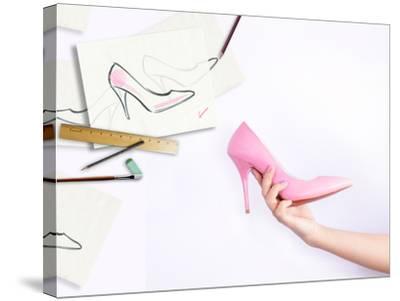 Female Hand Holding Shoe-Anna Ismagilova-Stretched Canvas Print