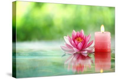Burning Candle and Water Lily in Water.-Liang Zhang-Stretched Canvas Print