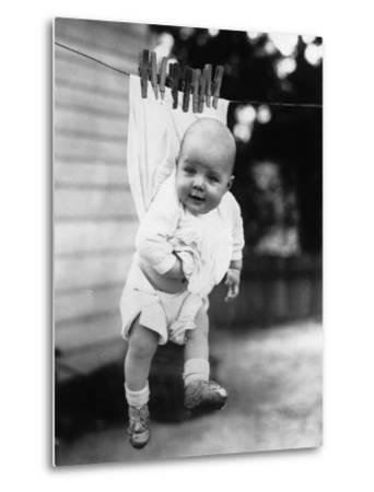 Baby (6-11 Months) Attached to Clothesline--Metal Print