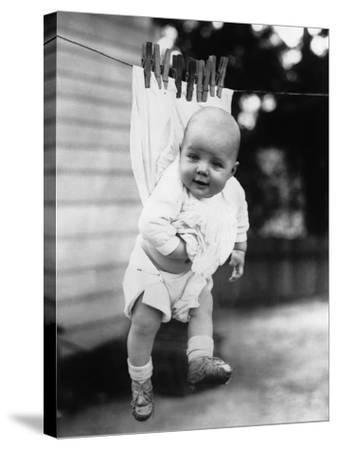 Baby (6-11 Months) Attached to Clothesline--Stretched Canvas Print