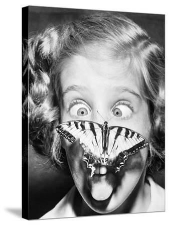 Butterfly Perched on Girl's Nose--Stretched Canvas Print