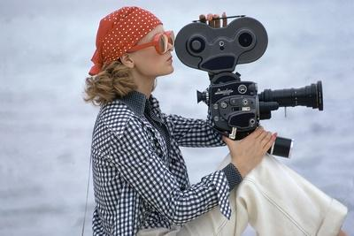 Side View of Model Holding a Movie Camera, Filming in Paradise Island, Bahamas-Gianni Penati-Stretched Canvas Print